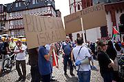 Frankfurt am Main | 26 July 2014<br /> <br /> Am Samstag (26.07.2014) demonstrierten etwa 500 Menschen auf dem R&ouml;merberg in Frankfurt am Main f&uuml;r Frieden in Pal&auml;stina / Gaza und f&uuml;r ein sofortiges Ende der israelischen Milit&auml;reins&auml;tze dort.<br /> Hier: Einige Teilnehmer der Demo f&uuml;hrten Transparente mit offen israelfeindlichen Spr&uuml;chen mit, hier z.B. &quot;Blutsauger Israel&quot; und &quot;IsReal Terrorist&quot;.<br /> <br /> &copy;peter-juelich.com<br /> <br /> FOTO HONORARPFLICHTIG!<br /> <br /> [No Model Release | No Property Release]