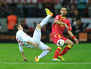 Montenegro's Vladimir Bozovic and Waldemar Sobota of Poland during the FIFA World Cup 2014 group H qualifying football match of Poland vs Montenegro on September 6, 2013 in Warsaw, <br />