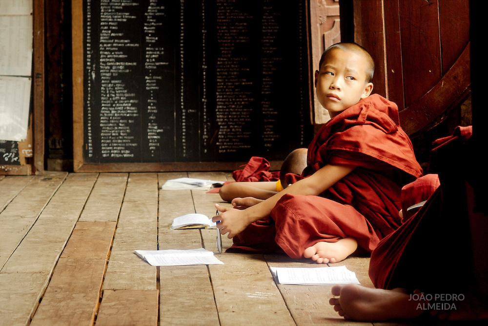 Monks inside Shwe Yan Pya  monastery classroom