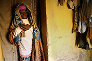 Djougou November 2006 - Old woman inside of her house in Djougou, Benin. © Jean-Michel Clajot