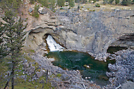 Natural Bridge State Monument. Boulder River,  Big Timber, Montana. At Natural Bridge during high water in the spring a waterfall comes over the top of the bridge but during low water the Boulder flows through this tunnel. Until 1988 there was a better bridge but it collapsed.