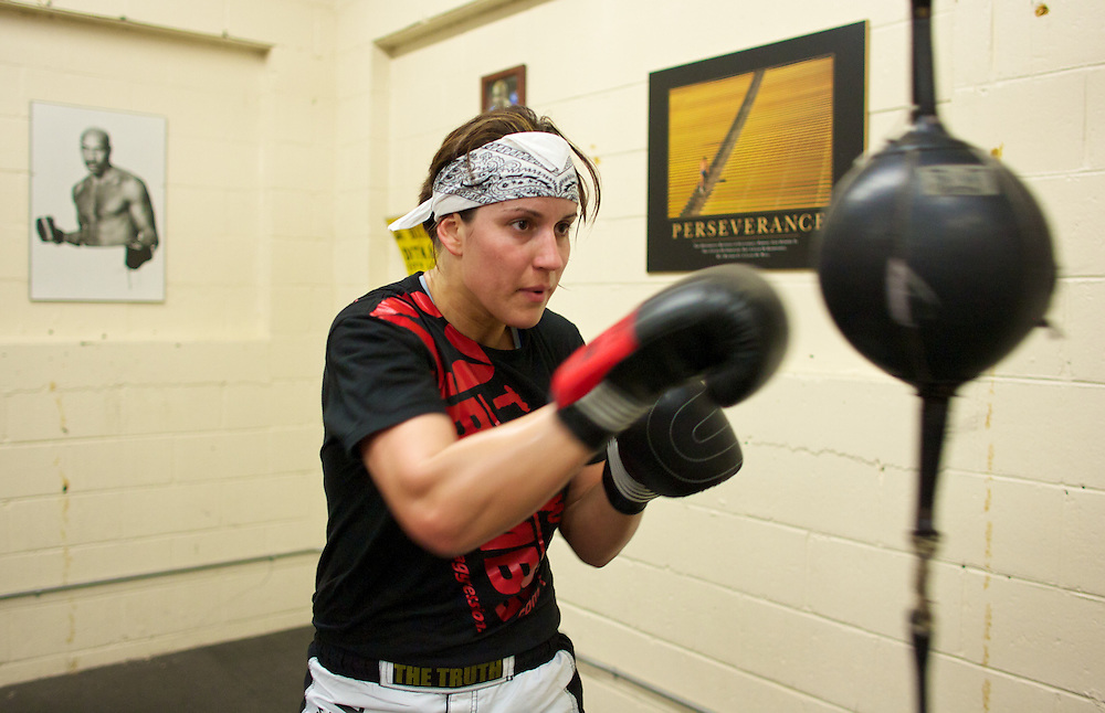 Windsor, Ontario ---10-05-06--- World Welterweight Champion, Mary Spencer hits a bag during a training session at the Windsor Amateur Boxing Club in Windsor, Ontario, May 6, 2010.<br /> GEOFF ROBINS The Globe and Mail