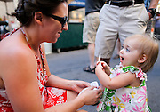 Stacy Jacobs, left, and Lexi Jacobs, 1 1/2, of Fairport, at the Xerox Rochester International Jazz Festival on Sunday, June 22, 2014.