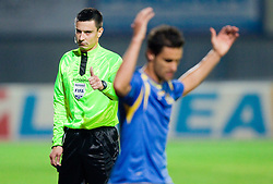 Wilson Xavier Junior of Domzale (R) on the way to wardrobe due to the red card by referee Slavko Vincic (L) during the football match between NK Domzale and MIK CM Celje, played in the 10th Round of Prva liga football league 2010 - 2011, on September 22, 2010, Spors park, Domzale, Slovenia. Domzale defeated Celje 1 - 0. (Photo by Vid Ponikvar / Sportida)
