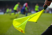A general view of the action and also assistant referee Andrew Garratt as he holds his flag during the Premier League match between Crystal Palace and Huddersfield Town at Selhurst Park, London, England on 30 March 2019.