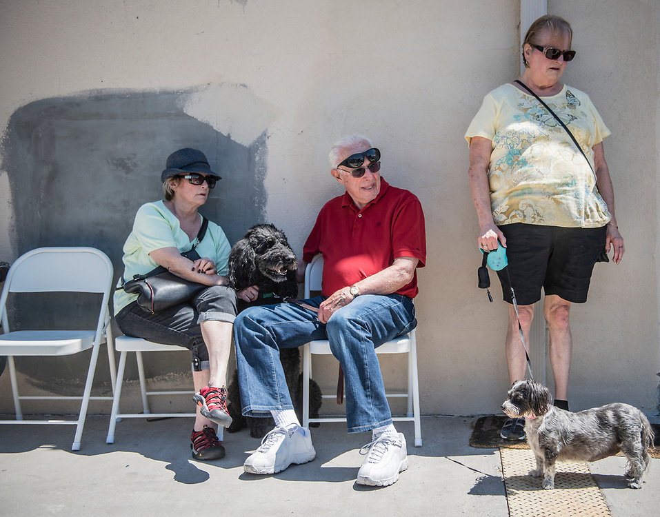 rer0603f/Rio Rancho/June 03, 2017/Albuquerque Journal<br /> Boofy's Best for Pets store in Albuquerque's westside  held a benefit dog was with a suggested donation of $10 dollars per wash to help and benefit F.A.T Katz- a no-kill,  foster based, all-volunteer, cat rescue and adoption group in Albuquerque.   Pictured from left to right are Sandy and Marvin Gladstone(cq) holding their beloved paddle Zazu and Doris Gervais(Cq) waiting patiently with Missy for their dogs to get a wash. <br />  Roberto E. Rosales/Albuquerque Journal