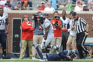 Mark Dodson (7) breaks off a long run against Carlos Davis (20) at Mississippi's Grove Bowl controlled scrimmage at Vaught-Hemingway Stadium in Oxford, Miss. on Saturday, April 5, 2014.