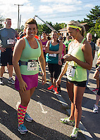 Runners and walkers  line up at the start line for 2013 WOW Fest at Laconia Athletic and Swim Club.   (Karen Bobotas/for the Laconia Daily Sun)