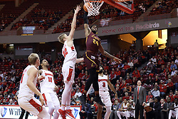 10 January 2018:  Aundre Jackson makes the slam while defended by Taylor Bruninga during a College mens basketball game between the Loyola Chicago Ramblers and Illinois State Redbirds in Redbird Arena, Normal IL