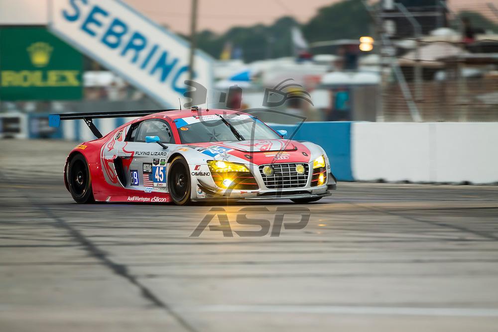 Sebring, FL - Mar 19, 2015:  The Flying Lizard Audi R8 LMS races through the turns at 12 Hours of Sebring at Sebring Raceway in Sebring, FL.