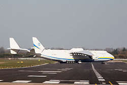 © Licensed to London News Pictures. 12/11/2015. Doncaster, UK. The world's largest aircraft made a rare visit to Yorkshire as it flew into Robin Hood Airport on an operational cargo mission. Only one AN-225 Mryia (Dream) was ever built by the company Antonov, and this giant of the skies, operated by Ukrainian company Antonov Airlines, landed in Doncaster to collect 150 tonnes of engineering equipment for a transatlantic flight. The AN-225 is 275 feet in length, with a wingspan of 290 feet and a maximum take-off weight of 640 tonnes. Photo credit: Andrew McCaren/LNP