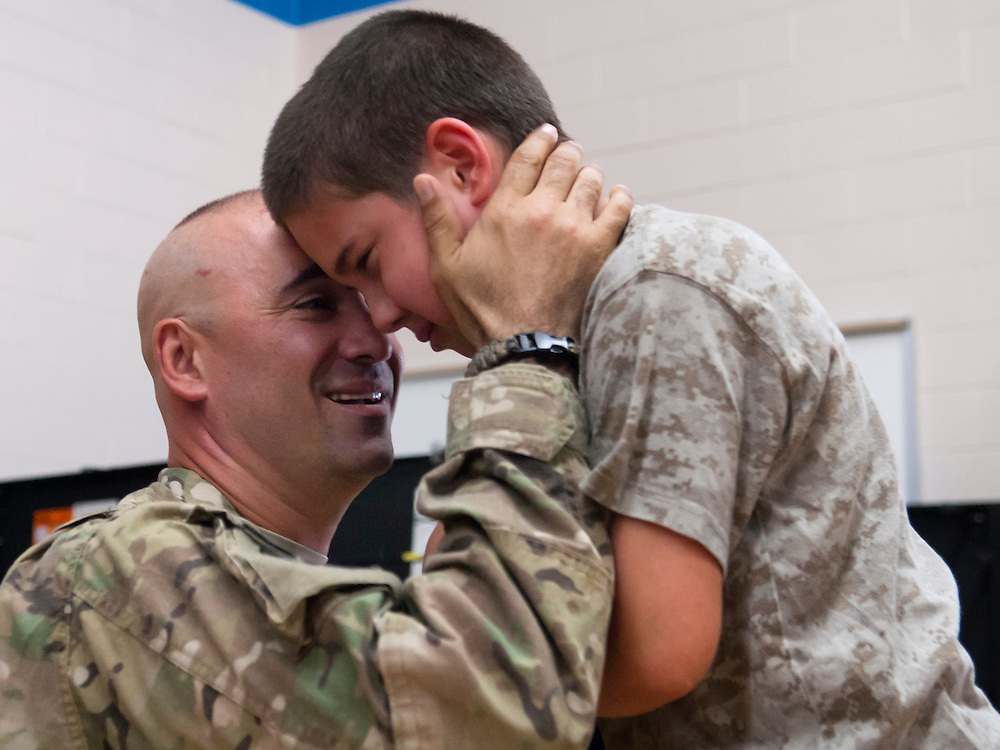 Lathan Goumas | MLive.com..Christopher Bratic, 10, rest his head on the forehead of his father United States Army Staff Sergeant Luis Bratic after the senior Bratic surprised his son during a school assembly at Lillian G. Mason Elementary Scho in Grand Blanc Township on Thursday June 7, 2012. Bratic returned from an 11-month deployment in Afghanistan to surprise his son who was not expecting him home til later in the month.