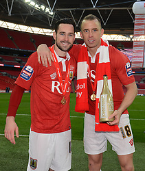 Bristol City's Greg Cunningham and Bristol City's Aaron Wilbraham celebrate the win against Walsall in the Johnstone Paint Trophy final - Photo mandatory by-line: Dougie Allward/JMP - Mobile: 07966 386802 - 22/03/2015 - SPORT - Football - London - Wembley Stadium - Bristol City v Walsall - Johnstone Paint Trophy Final