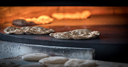 20 February 2020, Za'atari, Jordan: Bread moves through the oven in a bakery in Za'atari, Jordan.