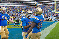 17 October 2012: Tailback (23) Jonathan Franklin of the UCLA Bruins runs the ball, scores a touchdown, and celebrates with teammate (17) Brett Hundley while playing against the USC Trojans during the second half of UCLA's 38-28 victory over USC at the Rose Bowl in Pasadena, CA.