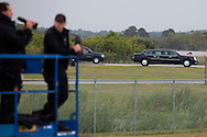 CAPE CANAVERAL, FL -  APRIL 15:  Security officers watch as United States President Barack Obama rides to reboard Air Force One at the shuttle landing facility at Kennedy Space Center April 15, 2010 in Cape Canaveral. Obama was holding a summit to discuss the future of the space program. (Photo by Matt Stroshane/Getty Images)