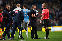 MANCHESTER, ENGLAND - Wednesday, March 24, 2010: Manchester City's manager Roberto Mancini complains to referee Peter Walton before he is sent off after challenging Everton's manager David Moyes during the Premiership match at the City of Manchester Stadium. (Photo by David Rawcliffe/Propaganda)