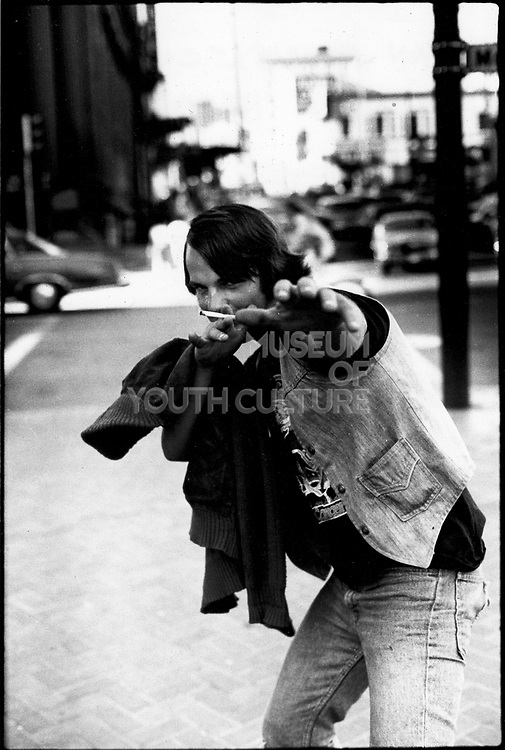 A Denim dressed rock teenager pointing at the camera, San Francisco, USA, 1980
