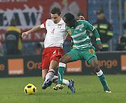 POZNAN 17/11/2010.FOOTBALL INTERNATIONAL FRIENDLY.POLAND v IVORY COAST.Maciej Sadlok of Poland and of Gervinho of Ivory Coast.Fot: Piotr Hawalej / WROFOTO