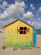 a funny painted little house on the beach Holland