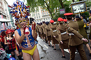 © Licensed to London News Pictures. 07/07/2012. London, UK A man photographs  members of the Army as they march. Guests at the World Pride Procession in Central London today 7th July 2012. Despite reports of it's cancellation due to financial difficulty the scaled-down event went ahead after changes to its schedule. Photo credit : Stephen Simpson/LNP