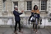 Street Fashion at Somerset house on day 4 of London Fashion Week February 17, 2014.<br /> <br /> <br /> Photo by Ki Price