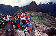 PERU, PREHISPANIC, INCA Machu Picchu; school children at site