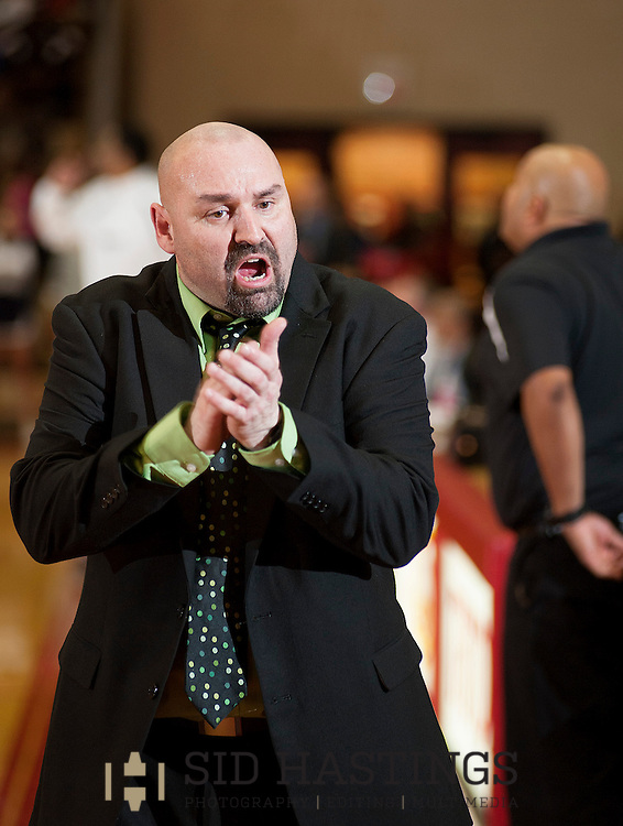 6 MARCH 2013 -- NORMANDY, Mo. -- Ft. Zumwalt North High School basketball coach Charles Glotta encourages his team during their game against McCluer North High School during the MSHSAA Class 5 sectional semifinal game at the University of Missouri - St. Louis in Normandy Wednesday, March 6, 2013. Photo © copyright 2013 Sid Hastings.