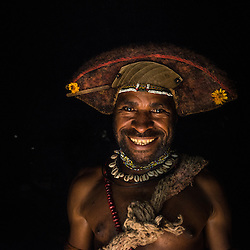 Young Huli man shows his wig made of his own hair, that he has grown for several years, Tari, PNG.