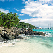 A small rocky headland at the northern end of White Bay on Jost Van Dyke in the British Virgin Islands in the Caribbean.