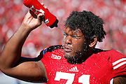 MADISON, WI - OCTOBER 25: Wisconsin Badgers offensive lineman Ray Ball #71 cools off by spraying water on his face during the football game against the Maryland Terrapins at Camp Randall Stadium on October 25, 2014 in Madison, Wisconsin. (Photo by Joe Robbins)