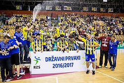 Luka Zvizej and other players of Celje celebrate as National Champions 2017 during trophy ceremony after handball match between RK Celje Pivovarna Lasko and RK Gorenje Velenje in Last Round of 1. Liga NLB 2016/17, on June 2, 2017 in Arena Zlatorog, Celje, Slovenia. Photo by Vid Ponikvar / Sportida