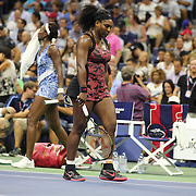 Serena Williams, USA and sister Venus Williams, USA, change ends during their Women's Singles Quarterfinals match won by Serena during the US Open Tennis Tournament, Flushing, New York, USA. 8th September 2015. Photo Tim Clayton