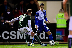 Tom Nichols of Bristol Rovers is challenged by Gary Sawyer of Plymouth Argyle - Mandatory by-line: Ryan Hiscott/JMP - 17/12/2019 - FOOTBALL - Home Park - Plymouth, England - Plymouth Argyle v Bristol Rovers - Emirates FA Cup second round replay