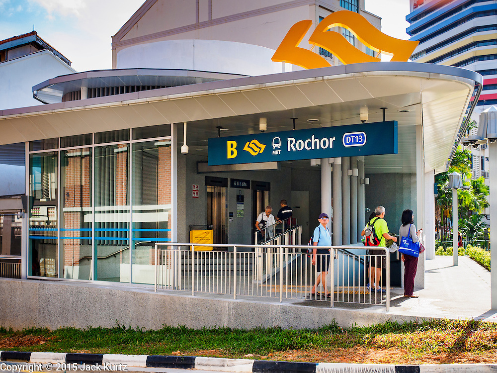 """27 DECEMBER 2015 - SINGAPORE, SINGAPORE:  People come out of the Rochor subway station in the Little India section of Singapore on the first day the station was open. Singapore opened the extension of the Downtown Line on its subway system Sunday. The extension is a part of Singapore's plans to make the city-state a """"car lite"""" metropolis with plans to double the current subway to more than 360 kilometers of track by 2030. The government plans to have 80% of homes within a 10 minute walk of a subway station.   PHOTO BY JACK KURTZ"""