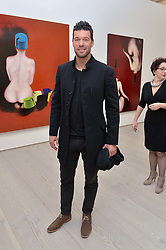 Footballer MICHAEL BALLACK at the launch of a new exhibition 'Le Tarbouche' by French-Lebanese artist Mouna Rebeiz held at The Saatchi Gallery, Duke of York's HQ, King's Road, London on 26th February 2015.