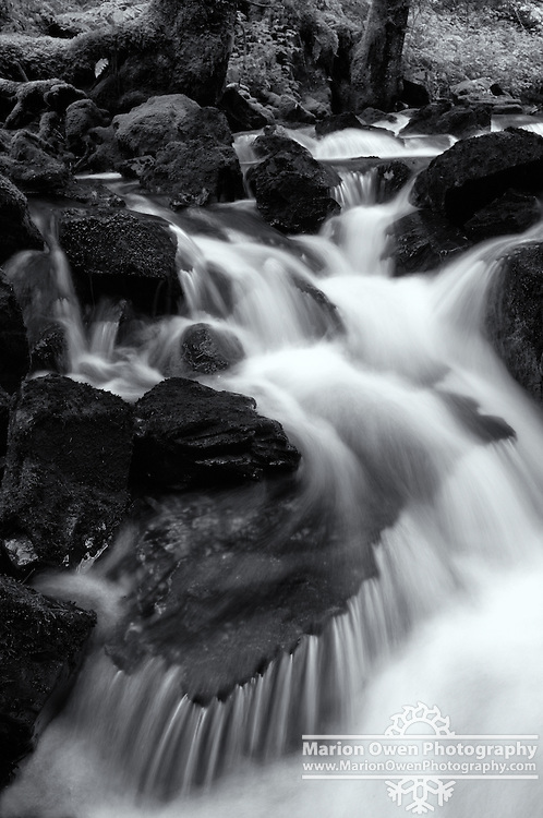 Water flows over rocks, creating ribbon-like skirt, Kodiak, Alaska