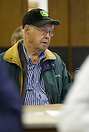 Gaylord Jones of Eagle Grove, Iowa keeps his eyes on the auctioneer as he bids at a farm auction at the Eagle Grove Masonic Lodge in Eagle Grove, Iowa on Thursday, October 18, 2012. Jones purchased the eighty acre property for $848,000 at $10,600 per acre.