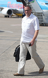 CARDIFF, WALES - Wednesday, September 1, 2010: Paul Abbandonato of Media Wales boards the official Wales team plane at Cardiff Airport as the squad head out to Podgorica ahead of the opening UEFA Euro 2012 Qualifying Group 4 match against Montenegro. (Pic by David Rawcliffe/Propaganda)
