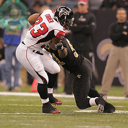 2008 December, 07: Atlanta Falcons running back Michael Turner (33) escapes a tackle by New Orleans Saints linebacker Jonathan Vilma (51) during a 29-25 victory by the New Orleans Saints over NFC South divisional rivals the Atlanta Falcons at the Louisiana Superdome in New Orleans, LA.