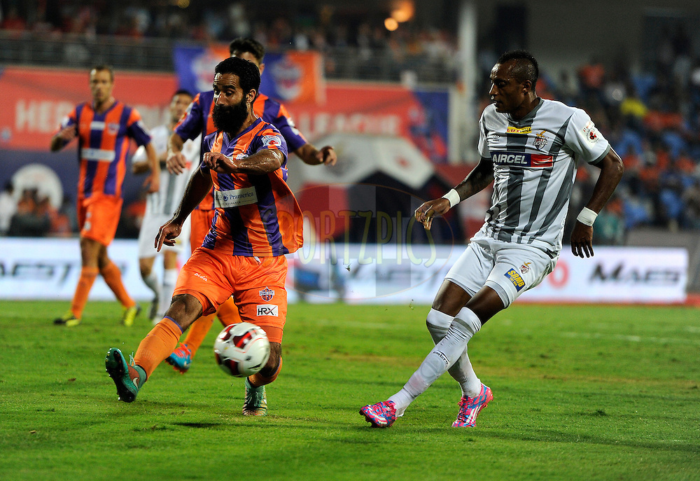 Mehrajuddin Wadoo of FC Pune City and Fikru Tefera Lemessa of Atletico de Kolkata during match 44 of the Hero Indian Super League between FC Pune City and Atletico de Kolkata FC held at the Shree Shiv Chhatrapati Sports Complex Stadium, Pune, India on the 29th November 2014.<br /> <br /> Photo by:  Pal Pillai/ ISL/ SPORTZPICS