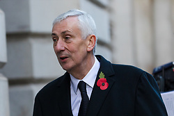 © Licensed to London News Pictures. 10/11/2019. London, UK. Sir Lindsay Hoyle, Speaker of the House of Commons walks through Downing Street to attend the Remembrance Sunday Ceremony at the Cenotaph in Whitehall. Remembrance Sunday events are held across the country today as the UK remembers and honours those who have sacrificed themselves in two world wars and other conflicts. Photo credit: Vickie Flores/LNP