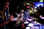 Frankfurt am Main | 29.03.2013..The Balconies, eine Indie-Rock-Pop-Band aos Toronto (Ontario, Canada) live im Zoom (früher Sinkkasten) in Frankfurt am Main. Hier: Sängerin Jacquie Neville mit der Band nach der Show am Mechandising-Stand...©peter-juelich.com..[No Model Release | No Property Release]