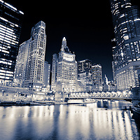 Chicago Michigan Avenue Bridge (DuSable Bridge) at night along the Chicago River with 111 East Wacker building, 333 North Michigan Avenue building, Crain Communications building (London Guarantee), Leo Burnett building, United Airlines building, and Trump International Hotel and Tower.