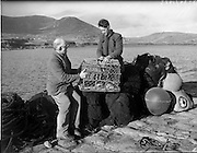 26-29/01/1960<br /> 01/26-29/1960<br /> 26-29 January 1960<br /> Gael-Linn Special at Gweedore and Teelin Co. Donegal. Two men working on what appear to be crab pots or traps on the quayside.