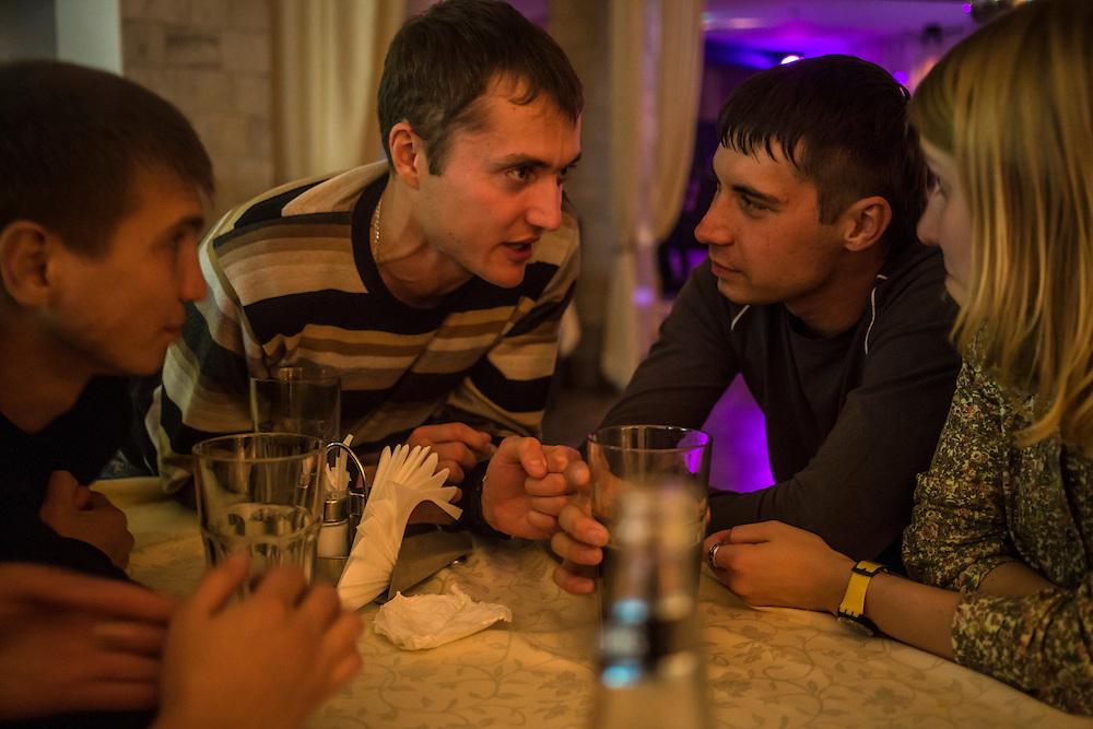 Sergei, Vadim Kovalenko, Maxim Makarov, and Marina Telezhnikova at a bar on Sunday, October 27, 2013 in Baikalsk, Russia.
