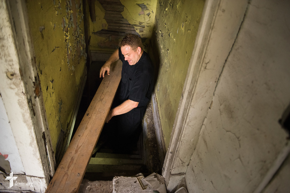 The Rev. Peter M. Burfeind, new domestic missionary and campus pastor at the University of Toledo, navigates through a vacant house as a potential new church on Thursday, July 9, 2015, in Toledo, Ohio. LCMS Communications/Erik M. Lunsford