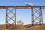 Cornwall, New York -  A Metro North Railroad crew works on the tracks on the Moodna Viaduct on Nov. 7, 2015. The trestle is the longest and highest railroad bridge east of the Mississippi River.