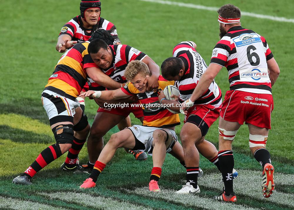 Waikato's Damian McKenzie is tackled during the ITM Cup rugby match - Waikato v Counties Manukau at Waikato Stadium, Hamilton on Sunday 14 September 2014.  Photo: Bruce Lim / www.photosport.co.nz
