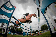 Overall Equitrek CCI*** winner CALLE 44 ridden by Yoshiaki Oiwa (JPN) sails over a combination fence during the final show jumping round on day four of Bramham International Horse Trials 2017 at Bramham Park, Bramham, United Kingdom on 11 June 2017. Photo by Mark P Doherty.
